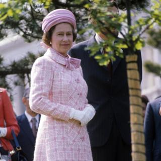 The Queen is seen beside an oak sapling which she planted in the garden of the government guesthouse in Tokyo
