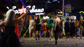 A participant in the annual Sydney Gay and Lesbian Mardi Gras parade wears horns as he looks back on the parade route in Sydney, Australia March 4, 2017