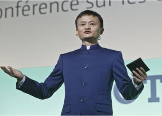 """Head of Alibaba Group Chinese Jack Ma gestures as he speaks during the """"Action Day"""" at the COP21, United Nations Climate Change Conference, in Le Bourget north of Paris, Saturday, 5 December 2015"""