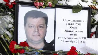 Photo of Russian Lt Col Oleg Peshkov among flowers outside the Russian Defence Ministry building in Moscow, Russia, 26 November 2015