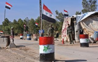 Syrian government forces guard a checkpoint after taking control of the village of Shamer on the northeastern outskirts of Aleppo on 7 March, 2017.