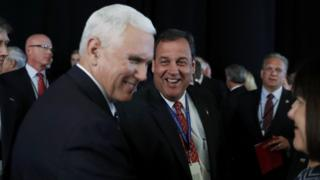 Vice-President-Elect Mike Pence greets New Jersey Governor Chris Christie.
