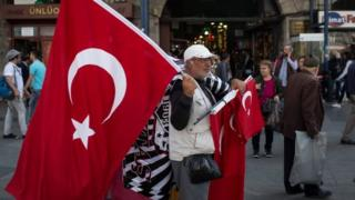 A man sells Turkish flags in Istanbul. Photo: 3 May 2015