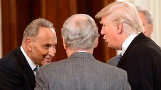 Chuck Schumer talks to Donald Trump