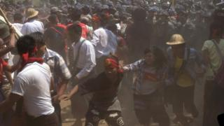 In this March 10, 2015 file photo, student protesters run as police officers charge them during a crackdown in Letpadan, 140 kilometres (90 miles) north of Yangon, Myanmar.