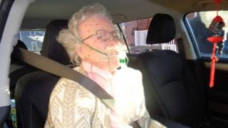 Lifelike mannequin in car