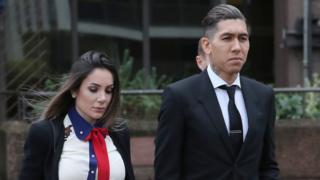 Larissa Pereira and Roberto Firmino leaving court