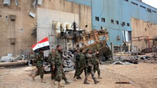 Syrian government forces patrol near Aleppo, 21 Feb
