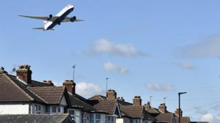 Plane comes in to land at Heathrow