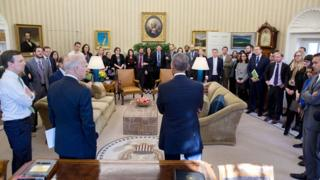 Mr Obama and Joe Biden face dozens of communication staff members, filling the Oval Office, on the day after Donald Trump's election victory.