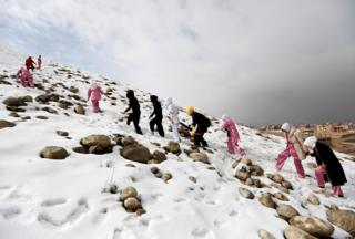 Students of the Shaolin Wushu club climb a hill as they arrive to practice in Kabul, Afghanistan.