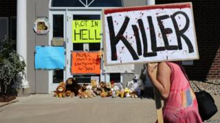 Protesters outside the dental practice run by Walter Palmer in Minnesota, the American accused of killing Cecil the lion in Zimbabwe - 29 July 2015