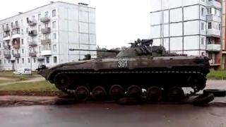 Tank drives over tyres in Zaslonava, Belarus