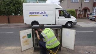 A BT Openreach engineer working on internet cables in the street
