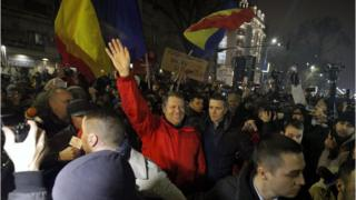 Romanian President Klaus Iohannis waves to protesters in Bucharest, Romania. 22 January 2017
