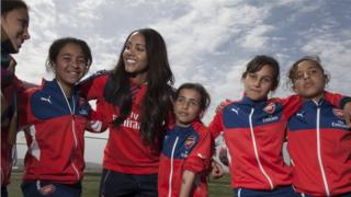 Alex Scott with some of the children
