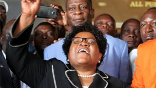 Zimbabwe's Joyce Mujuru gestures while addressing supporters in Harare, March 1, 2016.