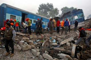 "Rescue workers search for survivors at the site of Sunday""s train derailment in Pukhrayan, south of Kanpur city, India November 21, 2016."