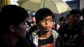 Hong Kong democracy protest leader Joshua Wong arrives at the Hong Kong international airport to see off fellow student leaders Alex Chow, Nathan Law and Eason Chung (not pictured) on their scheduled flight to Beijing on November 15, 2014.