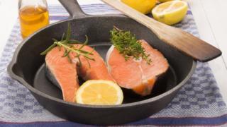 Salmon steaks in frying pan