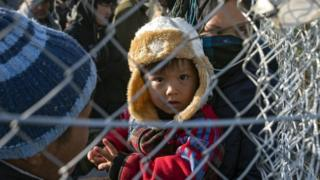 Afghan migrants behind a fence near Gevgelija, Macedonia