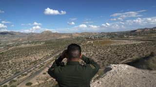 A US Border Patrol agent scans the US-Mexico border on 3 October