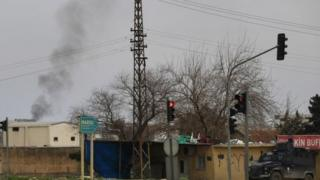 Smoke billows from a fire at the south-eastern town of Nusaybin, Turkey, near the border with Syria, where Turkish security forces are battling militants linked to the outlawed Kurdistan Workers, Party or PKK (14 February 2016)