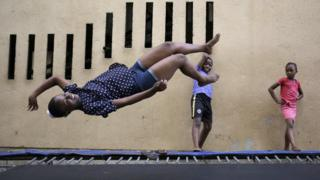 A girl jumps on one of the trampolines at the Alexandra Trampoline Club in Johannesburg, South Africa - Thursday 1 December 2016