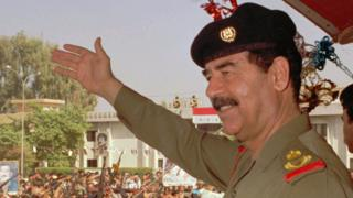 Iraqi President Saddam Hussein waves to supporters in Baghdad, 18 October 1995