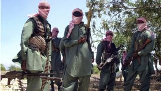 "members of Somalia""s al-Shabab jihadist movement seen during exercises at their military training camp outside Mogadishu in 2008"