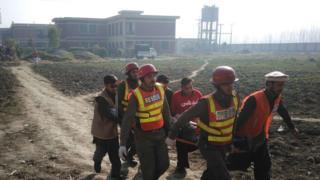 rescuers holding a stretcher