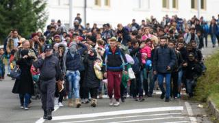 Migrants reach the Slovenian-Austrian border on 18 October 2015