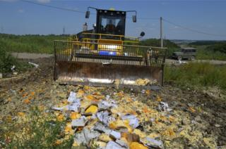 Russian bulldozer destroying packs of banned food in Belgorod, 6 Aug 15
