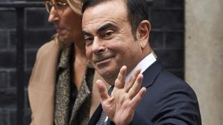 Nissan CEO Carlos Ghosn waves as he leaves No 10 Downing Street in central London on October 14, 2016, after meeting with British Prime Minister Theresa May
