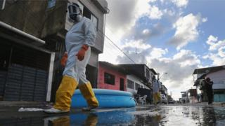Health workers walk while fumigating in an attempt to eradicate the mosquito which transmits the Zika virus on January 28, 2016 in Recife, Pernambuco state, Brazil.