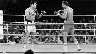 Muhammad Ali (L) (born Cassius Clay) and George Foreman in Kinshasa