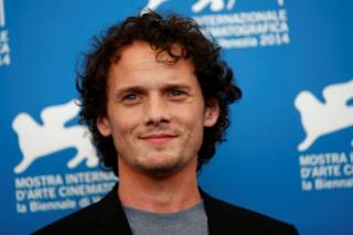 Anton Yelchin poses during the Venice Film Festival photo call for Burying the ex in 2014