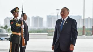 President Nursultan Nazarbayev of Kazakhstan (right, with guard standing to attention on the left) arrives at the G20 Summit, on September 4, 2016 in Hangzhou, China.