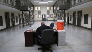 a guard in a cell block