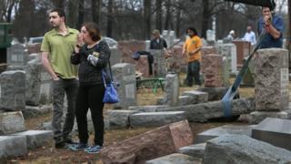 Mourners visit the vandalised Chesed Shel Emeth Cemetery in St Louis, Missouri, 21 February 2017