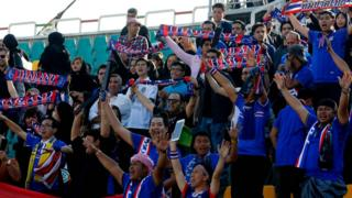 Thai fans cheer on their national team during the 2018 World Cup qualifying football match between Thailand and Iraq at the Shahid Dastgerdi Stadium in the Iranian capital, Tehran, on October 11, 2016.