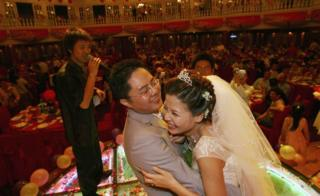 A couple dance at their wedding banquet