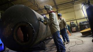 US industrial production slips on car-making and mining