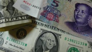 Dollars and Yuan banknotes