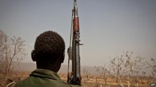 Rebel soldier looks out toward Talodi, in South Kordofan
