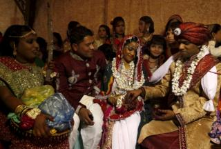 A couple go through a Hindu ritual during a mass marriage ceremony in Karachi in Pakistan's Sindh province on 24 January 2016.