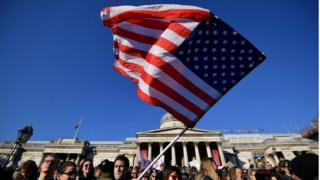 US flag being waved during Women's March in London on 21st January 2017