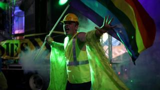 A participant in a construction outfit marches with the rainbow flag during the annual Sydney Gay and Lesbian Mardi Gras parade in Sydney, Australia March 4, 2017.