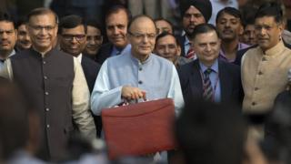 Indian Finance Minister Arun Jaitley, centre, leaves for annual budget presentation at parliament in New Delhi, India, Monday, Feb. 29, 2016