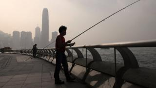 Men fishing in Hong Kong's Victoria Harbour